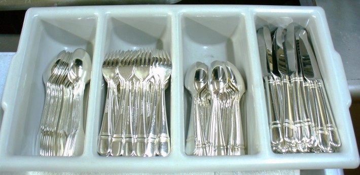 Polishing silver for hotel and restaurant diningware